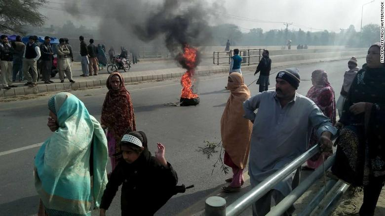 Mandatory Credit: Photo by STR/EPA-EFE/REX/Shutterstock (9314080a) People burn tyres during a protest against the murder and rape of seven-years-old girl named Zainab, in Kasur, Pakistan, 10 January 2018. A seven-years-old girl named Zainab was abducted, raped, and killed by unknown miscreant who threw her body in a dump, sparking an outrage among masses who demanded the police to arrest the culprit. Protest against the rape and murder of a minor girl in Pakistan, Kasur - 10 Jan 2018