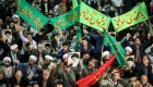 TOPSHOT - Iranians chant slogans as they march in support of the government near the Imam Khomeini grand mosque in the capital Tehran on December 30, 2017. Tens of thousands of regime supporters marched in cities across Iran in a show of strength for the regime after two days of angry protests directed against the country's religious rulers. / AFP PHOTO / TASNIM NEWS / HAMED MALEKPOUR (Photo credit should read HAMED MALEKPOUR/AFP/Getty Images)