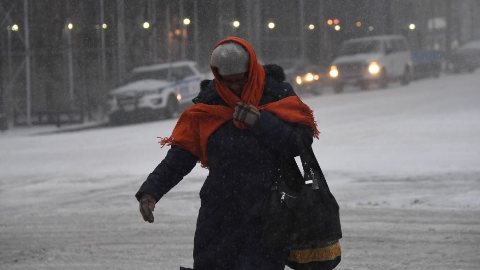 People walk through snow on January 4, 2018 in Brooklyn, New York. The US National Weather Service warned that a major winter storm would bring heavy snow and ice, from Florida in the southeast up to New England and the Northeast on Wednesday and Thursday. / AFP PHOTO / ANGELA WEISS (Photo credit should read ANGELA WEISS/AFP/Getty Images)
