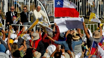 Pope Francis waves from the popemobile as he arrives at Maquehue airport in Temuco, 800 km south of Santiago, to celebrate an open-air mass on January 17, 2018. Pope Francis arrived to the heartland of the Mapuche, Chile's largest indigenous group, which complains of discrimination and abuse and is seeking the return of ancestral lands now in private hands. The visiting Pontiff will pay a short visit to Temuco to make direct contact with Mapuche leaders after presiding over a huge open air mass. / AFP PHOTO / Claudio Reyes (Photo credit should read CLAUDIO REYES/AFP/Getty Images)