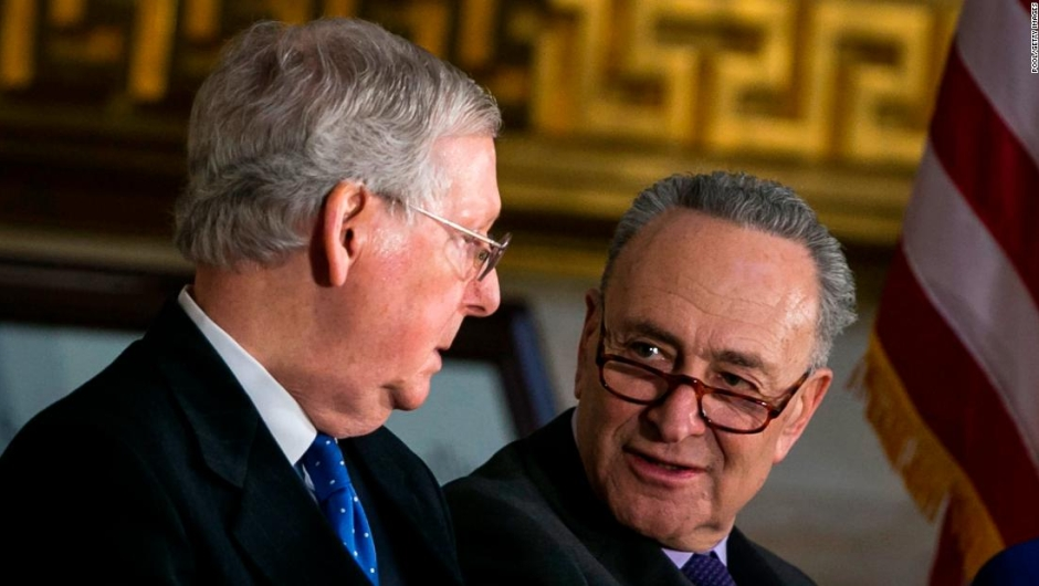 WASHINGTON, DC - JANUARY 17: Senate Majority Leader Mitch McConnell (R-KY) (L) and Senate Minority Leader Chuck Schumer (D-NY) talk during the congressional Gold Medal ceremony for former Senate Majority Leader Bob Dole at the U.S. Capitol January 17, 2018 in Washington D.C. (Photo by Al Drago-Pool/Getty Images)