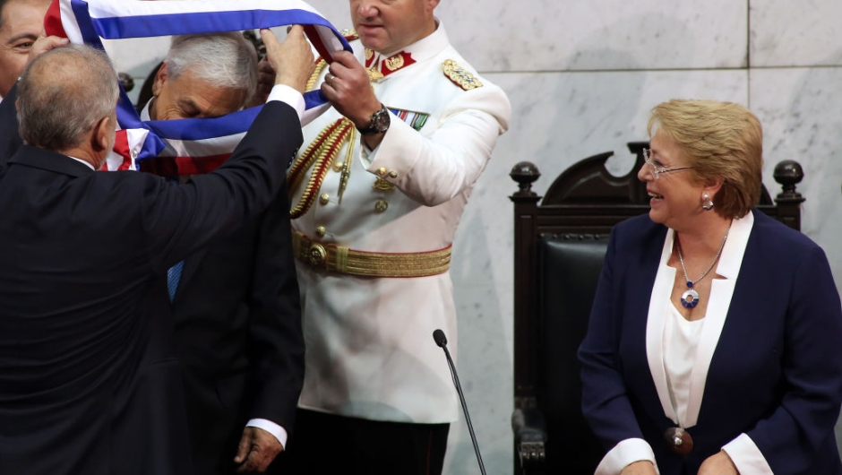 R) looks on during the inauguration ceremony at the Congress in Valparaiso, Chile, on March 11, 2018. Rightwing billionaire businessman Pinera was sworn in as the new president of Chile for the second time. / AFP PHOTO / CLAUDIO REYES (Photo credit should read CLAUDIO REYES/AFP/Getty Images)