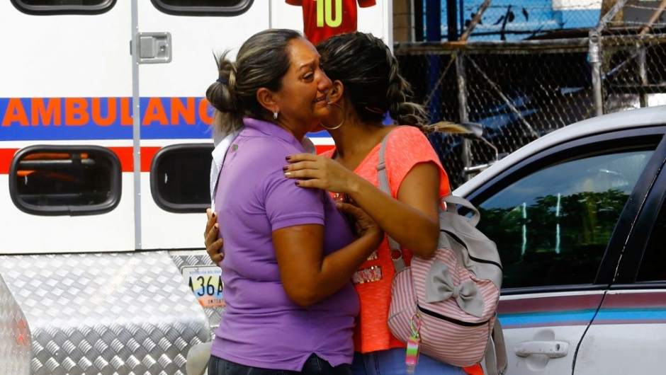 Relatives of prisoners cry in front of a police station in Valencia on March 28, 2018, after a fire engulfed police holding cells that resulted in the deaths of 68 people. A total of 68 people died on March 28 during an attempted jailbreak in Venezuela after a fire engulfed police holding cells in one of the worst tragedies in years in a notoriously violent and overcrowded prison system. / AFP PHOTO / Katherine ORTIZ / The erroneous mention[s] appearing in the metadata of this photo by Katherine ORTIZ has been modified in AFP systems in the following manner: [2018] instead of [2017]. Please immediately remove the erroneous mention[s] from all your online services and delete it (them) from your servers. If you have been authorized by AFP to distribute it (them) to third parties, please ensure that the same actions are carried out by them. Failure to promptly comply with these instructions will entail liability on your part for any continued or post notification usage. Therefore we thank you very much for all your attention and prompt action. We are sorry for the inconvenience this notification may cause and remain at your disposal for any further information you may require. (Photo credit should read KATHERINE ORTIZ/AFP/Getty Images)