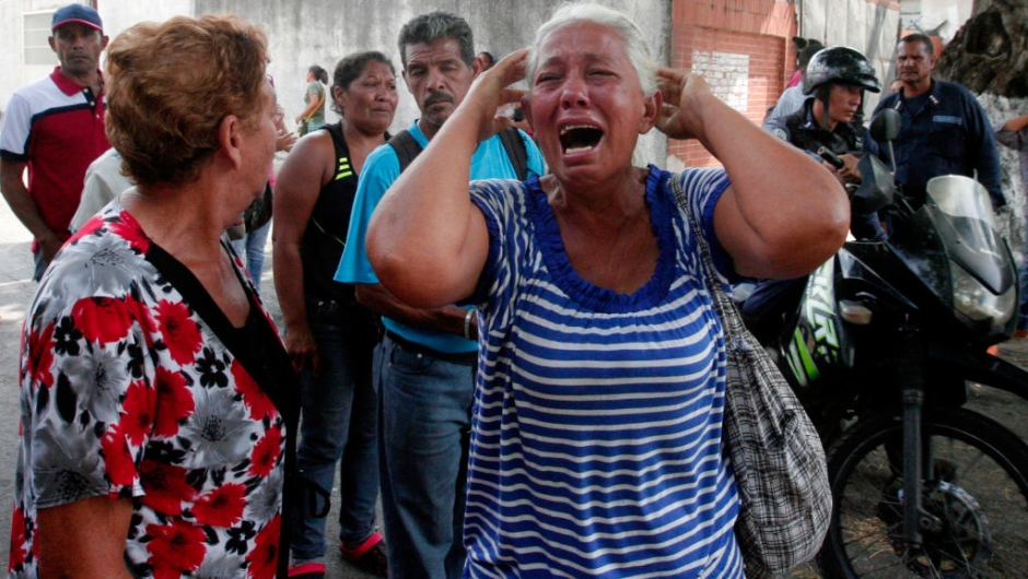 relative of a prisoner cries in front of a police station in Valencia on March 28, 2018, after a fire engulfed police holding cells that resulted in the deaths of 68 people. A total of 68 people died on March 28 during an attempted jailbreak in Venezuela after a fire engulfed police holding cells in one of the worst tragedies in years in a notoriously violent and overcrowded prison system. / AFP PHOTO / Katherine ORTIZ / The erroneous mention[s] appearing in the metadata of this photo by Katherine ORTIZ has been modified in AFP systems in the following manner: [2018] instead of [2017]. Please immediately remove the erroneous mention[s] from all your online services and delete it (them) from your servers. If you have been authorized by AFP to distribute it (them) to third parties, please ensure that the same actions are carried out by them. Failure to promptly comply with these instructions will entail liability on your part for any continued or post notification usage. Therefore we thank you very much for all your attention and prompt action. We are sorry for the inconvenience this notification may cause and remain at your disposal for any further information you may require. (Photo credit should read KATHERINE ORTIZ/AFP/Getty Images)