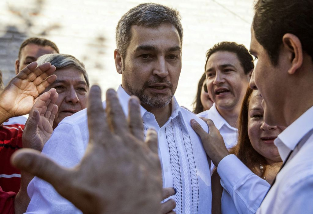Paraguay's presidential candidate of the Colorado Party, Mario Abdo Benitez (C) greets supporters after casting his vote at a polling station in Asuncion on April 22, 2018 during the country's presidential election. - Opinion polls give Mario Abdo Benitez of the ruling conservative Colorado party a clear lead over his centrist opponent, Efrain Alegre, in a two-horse race to succeed outgoing conservative President Horacio Cartes. (Photo by EITAN ABRAMOVICH / AFP) (Photo credit should read EITAN ABRAMOVICH/AFP/Getty Images)