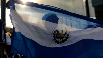 KANSAS CITY, KS - MARCH 31: An El Salvador fan waves a flag during a game against Honduras in the first half of the 2012 CONCACAF Men's Olympic Qualifying Semifinals at Livestrong Sporting Park on March 31, 2012 in Kansas City, Kansas. (Photo by Ed Zurga/Getty Images)