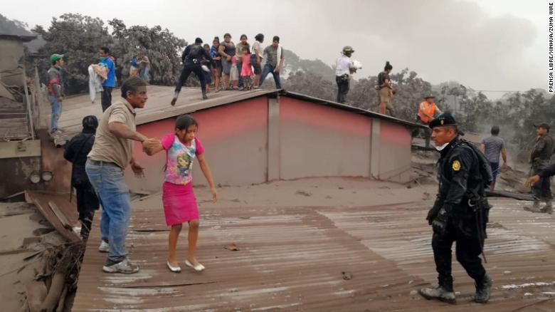 CHIMALTENANGO, June 4, 2018 Civil Protection members evacuate residents from a house during the eruption of the ''Volcan de Fuego'', in Acatenango, Chimaltenango Department, Guatemala, on June 3, 2018. At least seven people have been killed and 296 others injured in Guatemala as a highly active volcano near the country's capital erupted for the second time this year, authorities said Sunday. rtg) (ah) (Credit Image: ?? Prensa Libre/Xinhua via ZUMA Wire)