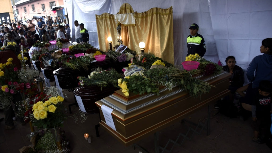 View of the coffins of seven people who died following the eruption of the Fuego volcano, at the morgue in Alotenango municipality, Sacatepequez, about 65 km southwest of Guatemala City, on June 4, 2018. - Rescue workers Monday pulled more bodies from under the dust and rubble left by an explosive eruption of Guatemala's Fuego volcano, bringing the death toll to at least 62. (Photo by JOHAN ORDONEZ / AFP) (Photo credit should read JOHAN ORDONEZ/AFP/Getty Images)