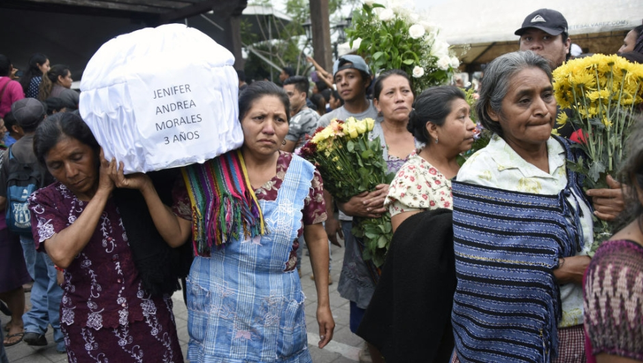 Two women carry the coffin of a little girl who died, following the eruption of the Fuego volcano, along the streets of Alotenango municipality, Sacatepequez, about 65 km southwest of Guatemala City, on June 4, 2018. - Rescue workers Monday pulled more bodies from under the dust and rubble left by an explosive eruption of Guatemala's Fuego volcano, bringing the death toll to at least 62. (Photo by JOHAN ORDONEZ / AFP) (Photo credit should read JOHAN ORDONEZ/AFP/Getty Images)