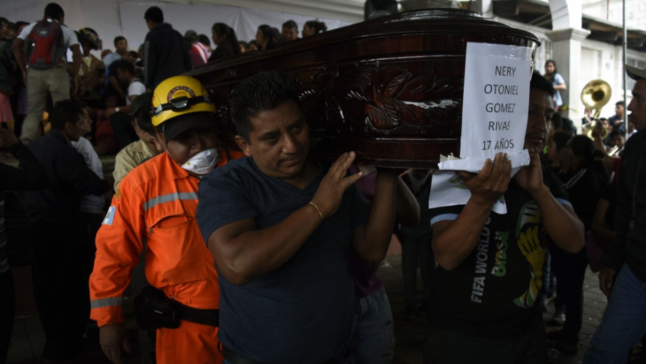 Residents and rescuers carry the coffin of one of the seven people who died following the eruption of the Fuego volcano, along the streets of Alotenango municipality, Sacatepequez, about 65 km southwest of Guatemala City, on June 4, 2018. - Rescue workers Monday pulled more bodies from under the dust and rubble left by an explosive eruption of Guatemala's Fuego volcano, bringing the death toll to at least 62. (Photo by JOHAN ORDONEZ / AFP) (Photo credit should read JOHAN ORDONEZ/AFP/Getty Images)