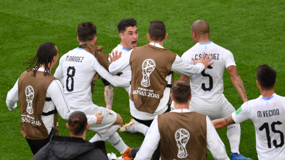 Uruguay's defender Jose Gimenez (C) celebrates with team-mates after scoring the opening goal during the Russia 2018 World Cup Group A football match between Egypt and Uruguay at the Ekaterinburg Arena in Ekaterinburg on June 15, 2018. (Photo by HECTOR RETAMAL / AFP) / RESTRICTED TO EDITORIAL USE - NO MOBILE PUSH ALERTS/DOWNLOADS (Photo credit should read HECTOR RETAMAL/AFP/Getty Images)