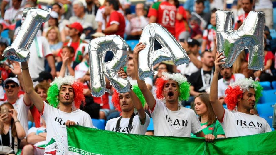 Iran fans cheer prior to the Russia 2018 World Cup Group B football match between Morocco and Iran at the Saint Petersburg Stadium in Saint Petersburg on June 15, 2018. (Photo by Paul ELLIS / AFP) / RESTRICTED TO EDITORIAL USE - NO MOBILE PUSH ALERTS/DOWNLOADS (Photo credit should read PAUL ELLIS/AFP/Getty Images)