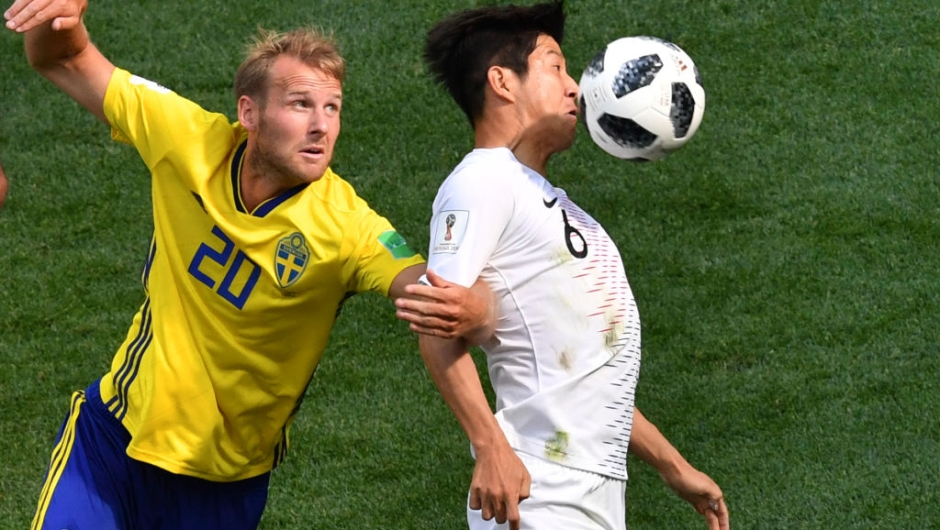 South Korea's defender Park Joo-ho (R) controls the ball ahead of Sweden's forward Ola Toivonen during the Russia 2018 World Cup Group F football match between Sweden and South Korea at the Nizhny Novgorod Stadium in Nizhny Novgorod on June 18, 2018. (Photo by Dimitar DILKOFF / AFP) / RESTRICTED TO EDITORIAL USE - NO MOBILE PUSH ALERTS/DOWNLOADS (Photo credit should read DIMITAR DILKOFF/AFP/Getty Images)