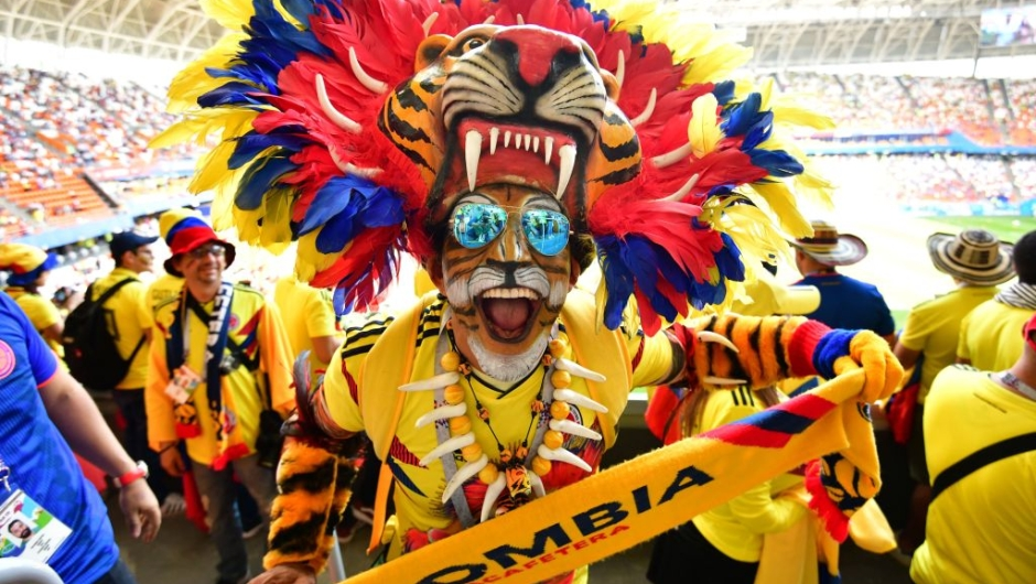 TOPSHOT - A Colombian fan sporting a tiger head poses before the Russia 2018 World Cup Group H football match between Colombia and Japan at the Mordovia Arena in Saransk on June 19, 2018. (Photo by Mladen ANTONOV / AFP) / RESTRICTED TO EDITORIAL USE - NO MOBILE PUSH ALERTS/DOWNLOADS (Photo credit should read MLADEN ANTONOV/AFP/Getty Images)