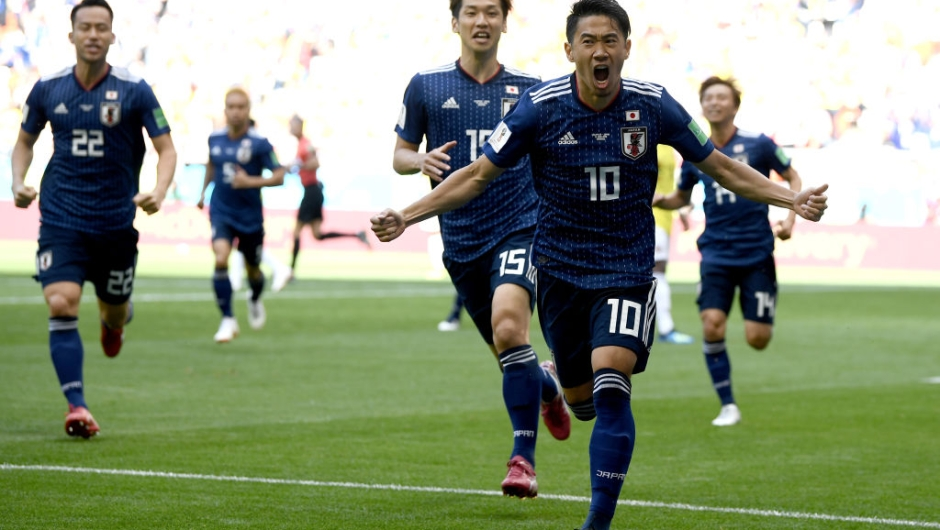 f Japan celebrates after scoring a penalty for his team's first goal during the 2018 FIFA World Cup Russia group H match between Colombia and Japan at Mordovia Arena on June 19, 2018 in Saransk, Russia. (Photo by Carl Court/Getty Images)