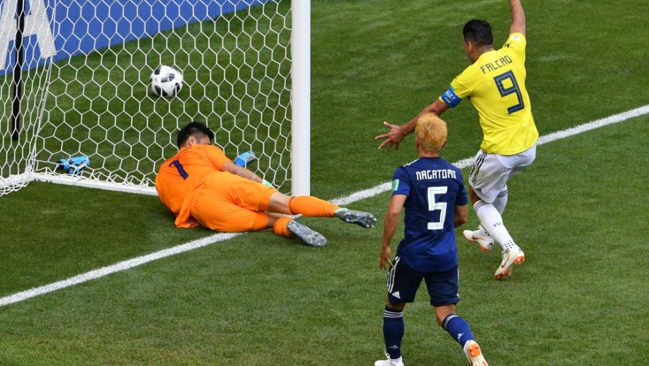 Japan's goalkeeper Eiji Kawashima (L) blocks the ball in his goal after Colombia's midfielder Juan Quintero (unseen) scored during the Russia 2018 World Cup Group H football match between Colombia and Japan at the Mordovia Arena in Saransk on June 19, 2018. (Photo by Mladen ANTONOV / AFP) / RESTRICTED TO EDITORIAL USE - NO MOBILE PUSH ALERTS/DOWNLOADS (Photo credit should read MLADEN ANTONOV/AFP/Getty Images)