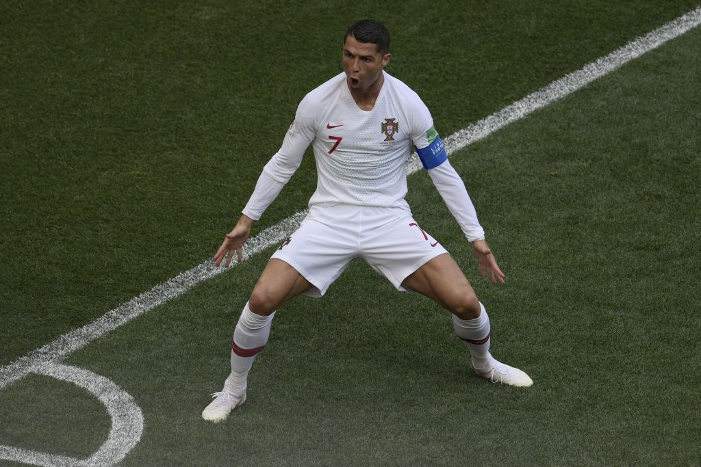 Portugal's forward Cristiano Ronaldo celebrates his opening goal for Portugal during the Russia 2018 World Cup Group B football match between Portugal and Morocco at the Luzhniki Stadium in Moscow on June 20, 2018. (Photo by Juan Mabromata / AFP) / RESTRICTED TO EDITORIAL USE - NO MOBILE PUSH ALERTS/DOWNLOADS (Photo credit should read JUAN MABROMATA/AFP/Getty Images)