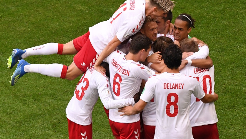 TOPSHOT - Denmark's midfielder Christian Eriksen (R) celebrates with teammates after scoring a goal during the Russia 2018 World Cup Group C football match between Denmark and Australia at the Samara Arena in Samara on June 21, 2018. (Photo by EMMANUEL DUNAND / AFP) / RESTRICTED TO EDITORIAL USE - NO MOBILE PUSH ALERTS/DOWNLOADS (Photo credit should read EMMANUEL DUNAND/AFP/Getty Images)