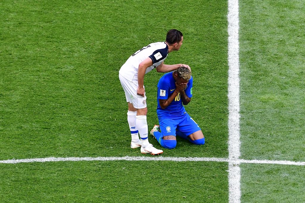 Brazil's forward Neymar (R) cries next to Costa Rica's defender Bryan Oviedo at the end of the Russia 2018 World Cup Group E football match between Brazil and Costa Rica at the Saint Petersburg Stadium in Saint Petersburg on June 22, 2018. (Photo by Giuseppe CACACE / AFP) / RESTRICTED TO EDITORIAL USE - NO MOBILE PUSH ALERTS/DOWNLOADS (Photo credit should read GIUSEPPE CACACE/AFP/Getty Images)
