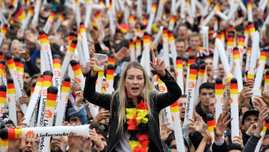 Supporters of the German national football team watch on a giant screen the Russia 2018 World Cup Group F football match between Germany and Sweden on June 23, 2018 in Berlin. (Photo by John MACDOUGALL / AFP) (Photo credit should read JOHN MACDOUGALL/AFP/Getty Images)