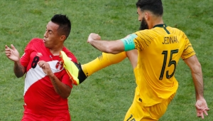 TOPSHOT - Australia's midfielder Mile Jedinak (R) fouls Peru's midfielder Christian Cueva during the Russia 2018 World Cup Group C football match between Australia and Peru at the Fisht Stadium in Sochi on June 26, 2018. (Photo by Odd ANDERSEN / AFP) / RESTRICTED TO EDITORIAL USE - NO MOBILE PUSH ALERTS/DOWNLOADS (Photo credit should read ODD ANDERSEN/AFP/Getty Images)