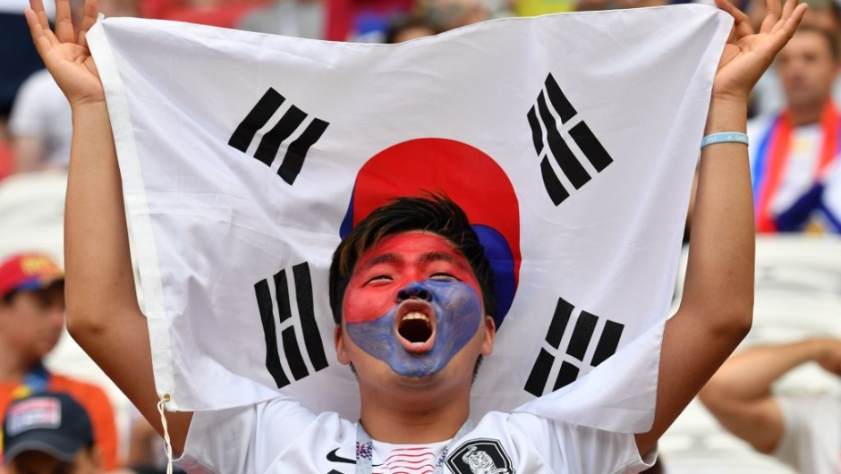 South Korea's fan cheers prior to the Russia 2018 World Cup Group F football match between South Korea and Germany at the Kazan Arena in Kazan on June 27, 2018. (Photo by SAEED KHAN / AFP) / RESTRICTED TO EDITORIAL USE - NO MOBILE PUSH ALERTS/DOWNLOADS (Photo credit should read SAEED KHAN/AFP/Getty Images)