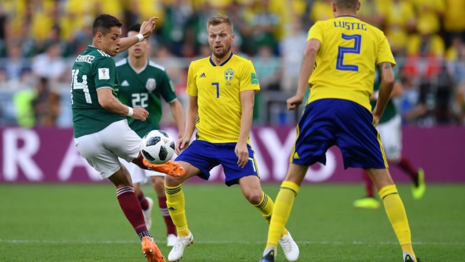 Mexico's forward Javier Hernandez and Sweden's midfielder Sebastian Larsson vie for the ball during the Russia 2018 World Cup Group F football match between Mexico and Sweden at the Ekaterinburg Arena in Ekaterinburg on June 27, 2018. (Photo by HECTOR RETAMAL / AFP) / RESTRICTED TO EDITORIAL USE - NO MOBILE PUSH ALERTS/DOWNLOADS (Photo credit should read HECTOR RETAMAL/AFP/Getty Images)