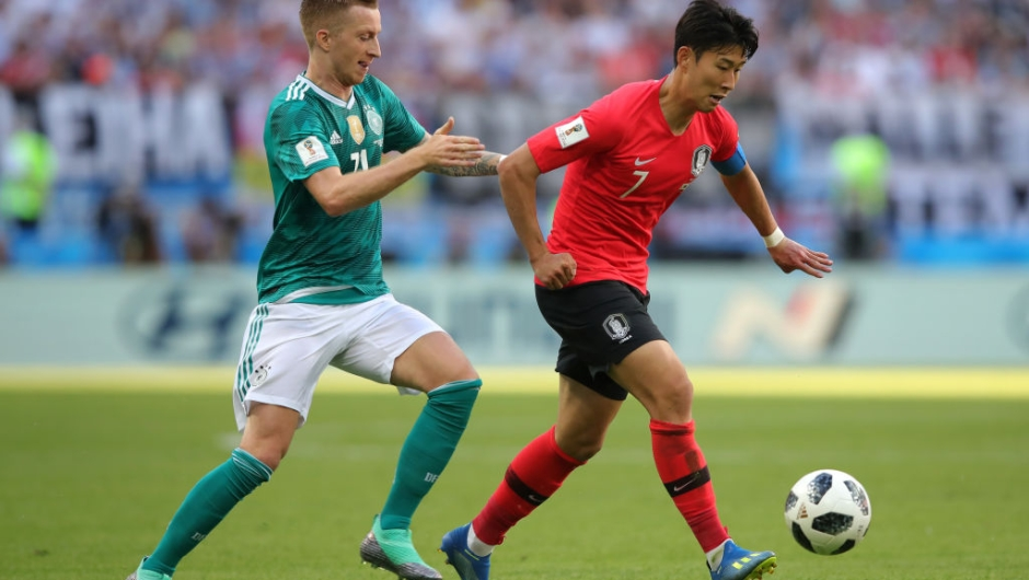 KAZAN, RUSSIA - JUNE 27: Heungmin Son of Korea Republic is challenged by Marco Reus of Germany during the 2018 FIFA World Cup Russia group F match between Korea Republic and Germany at Kazan Arena on June 27, 2018 in Kazan, Russia. (Photo by Alexander Hassenstein/Getty Images, )