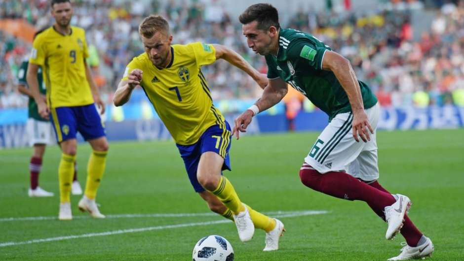 Sweden's midfielder Sebastian Larsson (L) and Mexico's midfielder Hector Herrera vie for the ball during the Russia 2018 World Cup Group F football match between Mexico and Sweden at the Ekaterinburg Arena in Ekaterinburg on June 27, 2018. (Photo by HECTOR RETAMAL / AFP) / RESTRICTED TO EDITORIAL USE - NO MOBILE PUSH ALERTS/DOWNLOADS (Photo credit should read HECTOR RETAMAL/AFP/Getty Images)