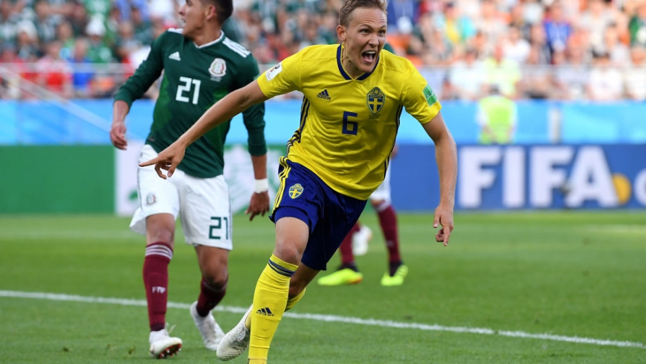 YEKATERINBURG, RUSSIA - JUNE 27: Ludwig Augustinsson of Sweden celebrates after scoring his team's first goal during the 2018 FIFA World Cup Russia group F match between Mexico and Sweden at Ekaterinburg Arena on June 27, 2018 in Yekaterinburg, Russia. (Photo by Matthias Hangst/Getty Images)