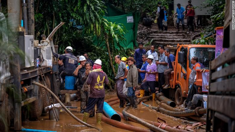 CHIANG RAI, THAILAND - JULY 2: Rescue workers work on the water pumping machine at the entrance of Tham Luang Nang Non cave on July 2, 2018 in Chiang Rai, Thailand. Rescuers from China and Australia have recently joined the search for 12 boys and their soccer coach who have been missing in Tham Luang Nang Non cave over a week ago after monsoon rains blocked the main entrance in northern Thailand. Divers believe they are closing in on the spot where the group could be sheltering as they continue to work their way through submerged passageways in the sprawling underground caverns and the search intensifies for the international rescue operation. (Photo by Linh Pham/Getty Images)
