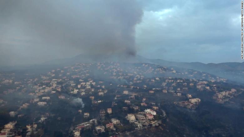 """This handout picture released by the Hellenic Ministry of Defence on July 24, 2018 shows an aerial view of the fire in Mati. The death toll from the wildfire ravaging the seaside areas around Athens has increased to 60 in Greece's deadliest blaze in more than a decade, on July 24, 2018. / AFP PHOTO / HELLENIC MINISTRY OF DEFENCE / - / RESTRICTED TO EDITORIAL USE - MANDATORY CREDIT """"AFP PHOTO /HELLENIC MINISTRY OF DEFENCE """" - NO MARKETING NO ADVERTISING CAMPAIGNS - DISTRIBUTED AS A SERVICE TO CLIENTS - NO ARCHIVE -/AFP/Getty Images"""