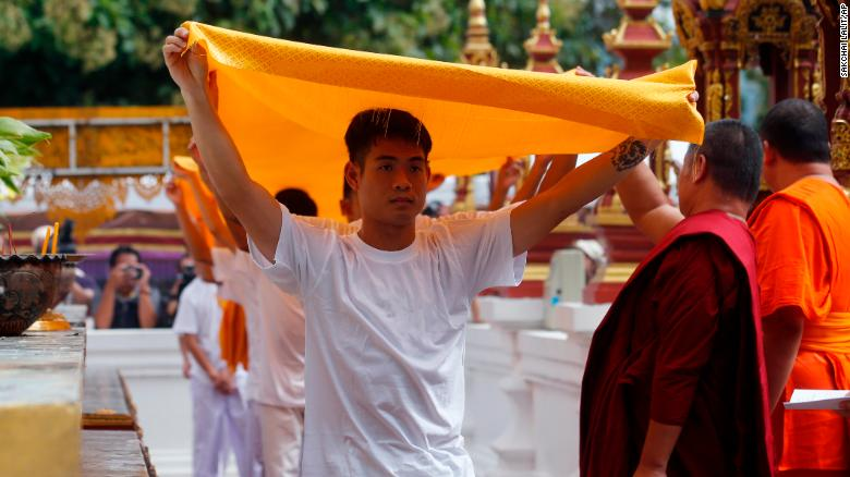 Soccer coach Ekkapol Janthawong, front, and members of the rescued soccer team attend a Buddhist ceremony that is believed to extend the lives of its attendees as well as ridding them of dangers and misfortunes in Mae Sai district, Chiang Rai province, northern Thailand, Tuesday, July 24, 2018. Eleven of the boys and their coach rescued last week from the flooded Tham Luang cave attend a merit making ceremony at a buddhist temple. The boys are also expected to have their heads shaved in the afternoon in preparation for their ordination as buddhist novices. (AP Photo/Sakchai Lalit)