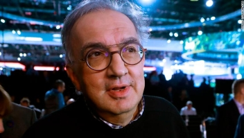 Sergio Marchionne, center, CEO of Fiat Chrysler Automobiles is interviewed after the unveiling of the new 2019 Jeep Cherokee during the North American International Auto Show, Tuesday, Jan. 16, 2018, in Detroit. (AP Photo/Carlos Osorio)
