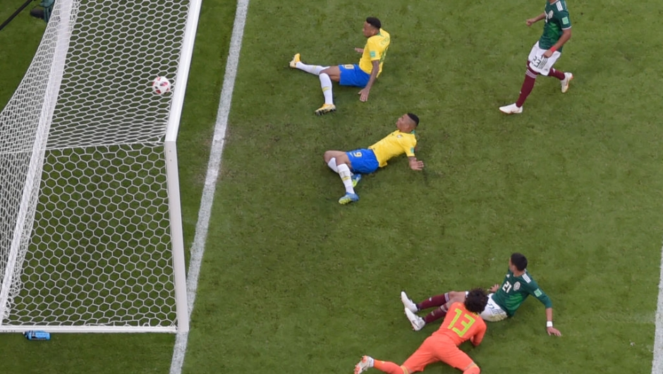 Brazil's forward Neymar (top, C) scores a goal during the Russia 2018 World Cup round of 16 football match between Brazil and Mexico at the Samara Arena in Samara on July 2, 2018. (Photo by - / AFP) / RESTRICTED TO EDITORIAL USE - NO MOBILE PUSH ALERTS/DOWNLOADS (Photo credit should read -/AFP/Getty Images)
