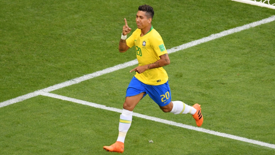 SAMARA, RUSSIA - JULY 02: Roberto Firmino of Brazil celebrates after scoring his team's second goal during the 2018 FIFA World Cup Russia Round of 16 match between Brazil and Mexico at Samara Arena on July 2, 2018 in Samara, Russia. (Photo by Hector Vivas/Getty Images)