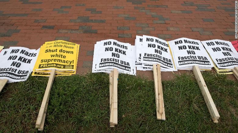 """WASHINGTON, DC - AUGUST 12:  Anti-KKK signs are layed out by counter protesters in Lafayette Park ahead of the planned white supremacists Unite the Right rally across from the White House August 12, 2018 in Washington, DC. Thousands of protesters are expected to demonstrate against the """"white civil rights"""" rally, which was planned by the organizer of last year's deadly rally in Charlottesville, Virginia.  (Photo by Chip Somodevilla/Getty Images)"""