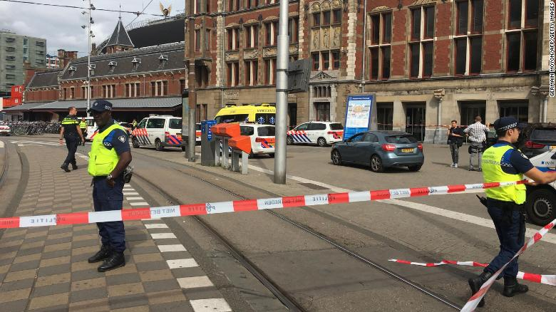 Security officials cordon off an area outside The Central Railway Station in Amsterdam on August 31, 2018, after two people were hurt in a stabbing incident. (Photo by Germain MOYON / AFP)        (Photo credit should read GERMAIN MOYON/AFP/Getty Images)