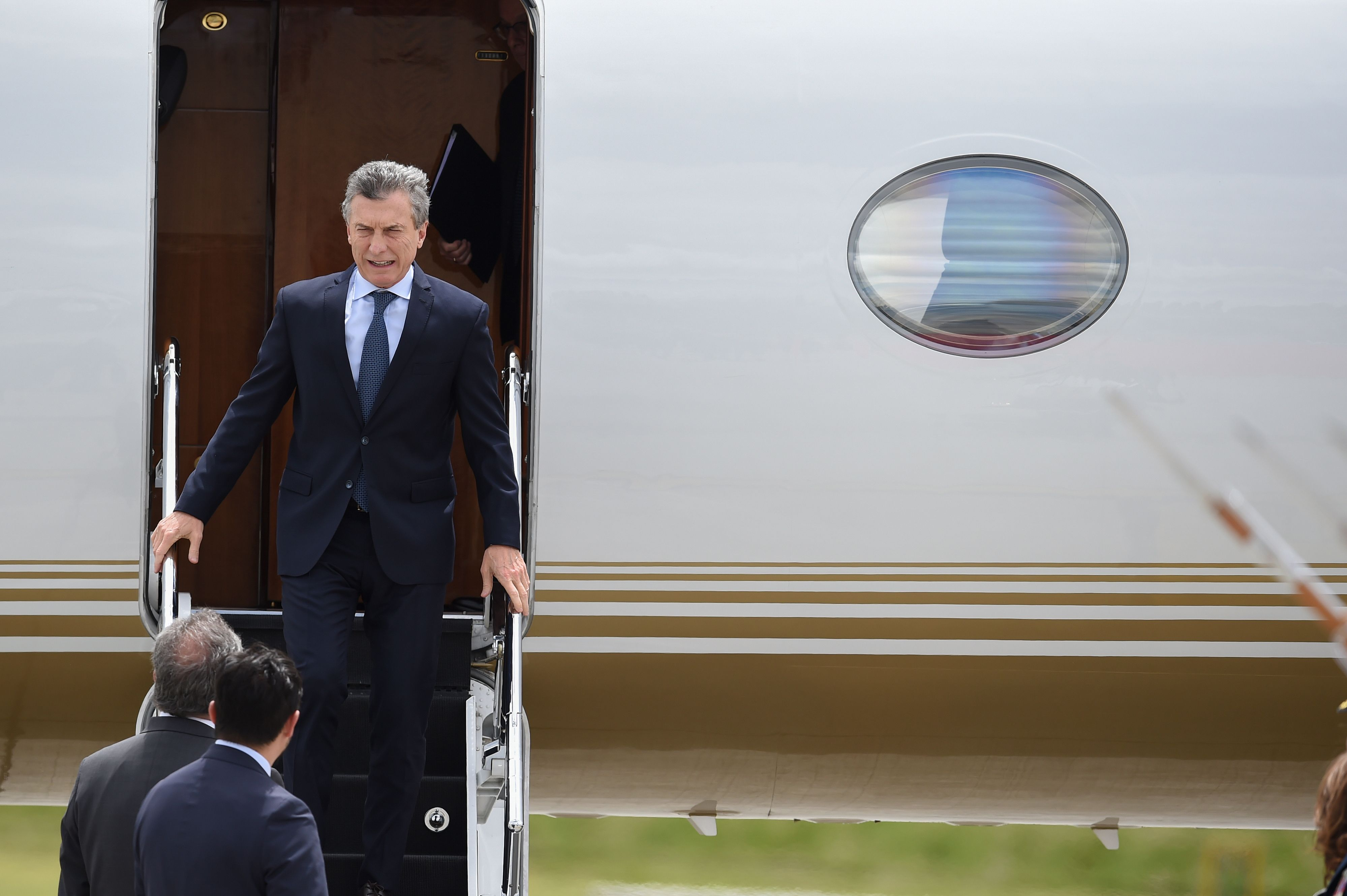 Argentine President Mauricio Macri arrives on August 7, 2018 at the CATAM military airport in Bogota, where he will attend Colombia's President Ivan Duque swearing-in ceremony. - Duque has his work cut out for him as he takes office Tuesday amid heightened tensions with neighbouring Venezuela and the lingering difficulties of peace-building with the nation's rebel groups. (Photo by Diana SANCHEZ / AFP) (Photo credit should read DIANA SANCHEZ/AFP/Getty Images)