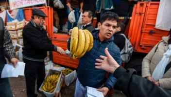 Producers give bananas for free during a protest at Plaza de Mayo square near the Casa Rosada presidential palace in Buenos Aires, on August 2, 2017. Banana producers gave away 30 tons of the fruit in demand of government assistance to try to reverse the complicated scenario that the domestic market is facing due to the importation of products at a very low price. / AFP PHOTO / Eitan ABRAMOVICH (Photo credit should read EITAN ABRAMOVICH/AFP/Getty Images)