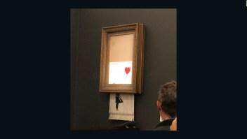 Mira cómo la pintura de 1.4 millones de dólares Banksy se autodestruye