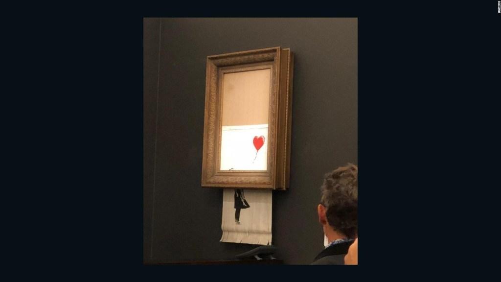 """La obra triturada de Banksy, """"La niña con un globo"""", fue rebautizada"""
