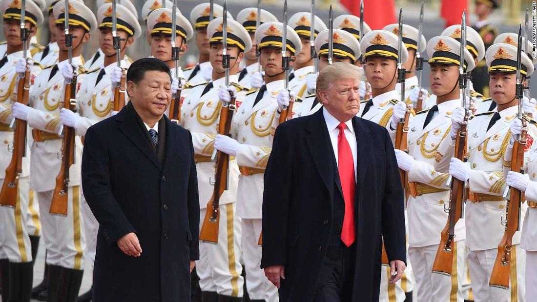 China's President Xi Jinping (L) and US President Donald Trump review Chinese honour guards during a welcome ceremony at the Great Hall of the People in Beijing on November 9, 2017. / AFP PHOTO / JIM WATSON (Photo credit should read JIM WATSON/AFP/Getty Images)