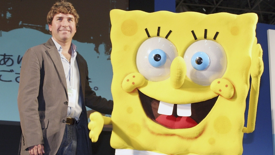 """TOKYO, JAPAN - MARCH 23: Stephen Hillenburg, the writer of a U.S. cartoon """"The SpongeBob SquarePants"""" poses with its charactor SpongeBob SquarePants at an event held at Tokyo International Anime Fair on March 23, 2006 in Tokyo, Japan. The film of this popular U.S. Cartoon will open on April 22 in Japan. (Photo by Junko Kimura/Getty Images)"""