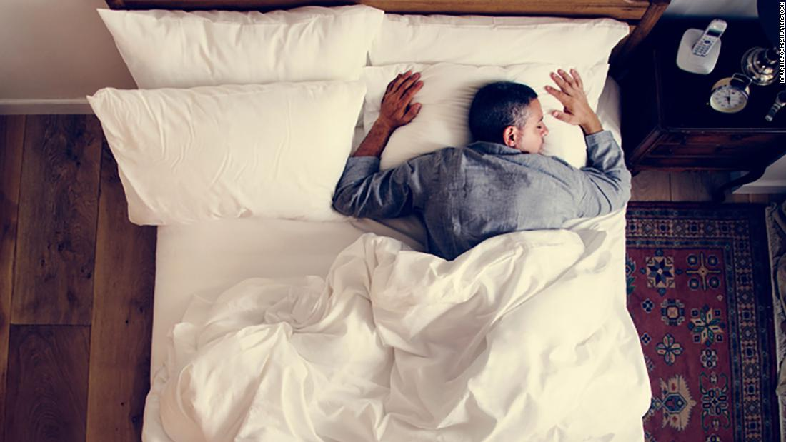 French man sleeping alone on bed; Shutterstock ID 1070512514; Job: sleep