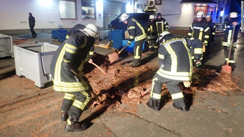 Spilt chocolate is cleared from a road in Werl, Germany December 10, 2018 in this picture obtained from social media. Picture taken December 10, 2018. FEUERWEHR WERL/via REUTERS THIS IMAGE HAS BEEN SUPPLIED BY A THIRD PARTY. MANDATORY CREDIT. NO RESALES. NO ARCHIVES.