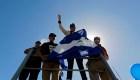Exiliados protestan contra Ortega en caravana de buses