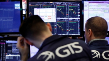 Specialists work at a post on the floor of the New York Stock Exchange, Wednesday, Dec. 26, 2018. Stocks are opening strongly higher on Wall Street Wednesday, with real estate, raw materials and energy stocks leading a broad rebound from Monday's steep losses. (AP Photo/Richard Drew)