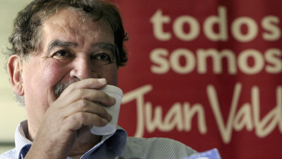 "Bogota, COLOMBIA: Carlos Sanchez, former ""Juan Valdez"" coffee grower icon, drinks a cup of coffee during a press conference 30 May, 2006 in Bogota. Sanchez, who for almost 37 years embodied the fictional Colombian Juan Valdez, announced he will hand over this representative character to a younger man. AFP PHOTOAlejandra VEGA (Photo credit should read ALEJANDRA VEGA/AFP/Getty Images)"