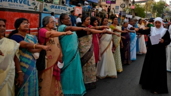 Women take pledge to fight gender discrimination as they form part of a 620 kilometers (388 miles) long 'women's wall' in Thiruvanathapuram, Kerala, India,Tuesday, Jan.1, 2019. The wall was organized in the backdrop of conservative protestors blocking the entry of women of menstruating age at the Sabarimala temple, one of the world's largest Hindu pilgrimage sites defying a recent ruling from India???s top court to let them enter. (AP Photo/R S Iyer)